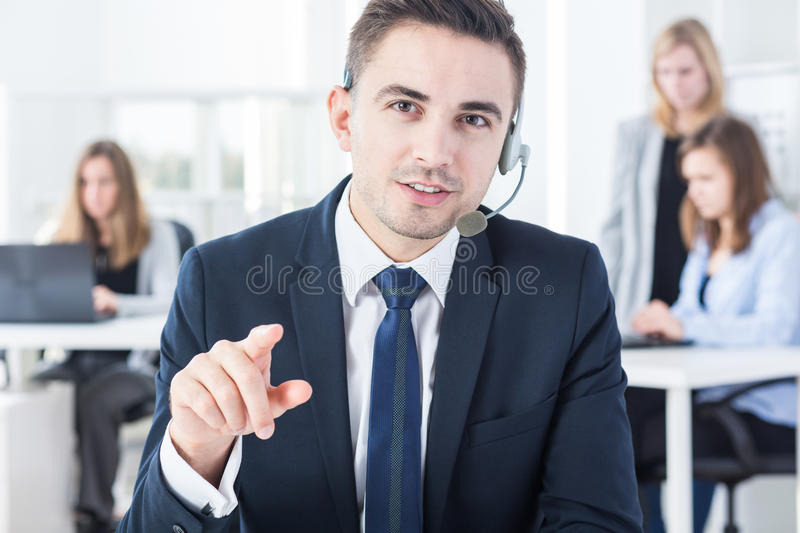 Man and telemarketing. Handsome young man with headset and telemarketing stock images