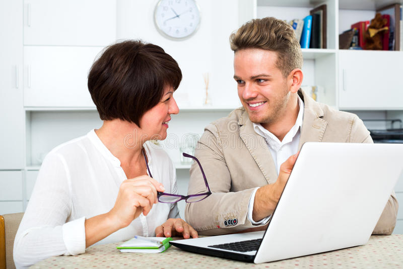 Man tells his mother about new software stock photography