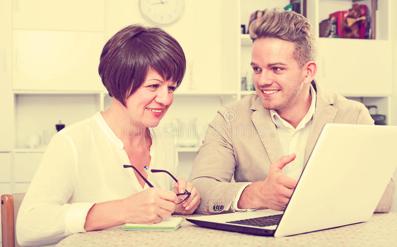 Man tells his mother about new software stock photos