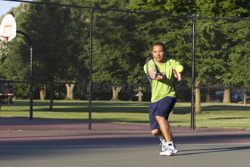 Man on Tennis Court Playing Tennis stock photo