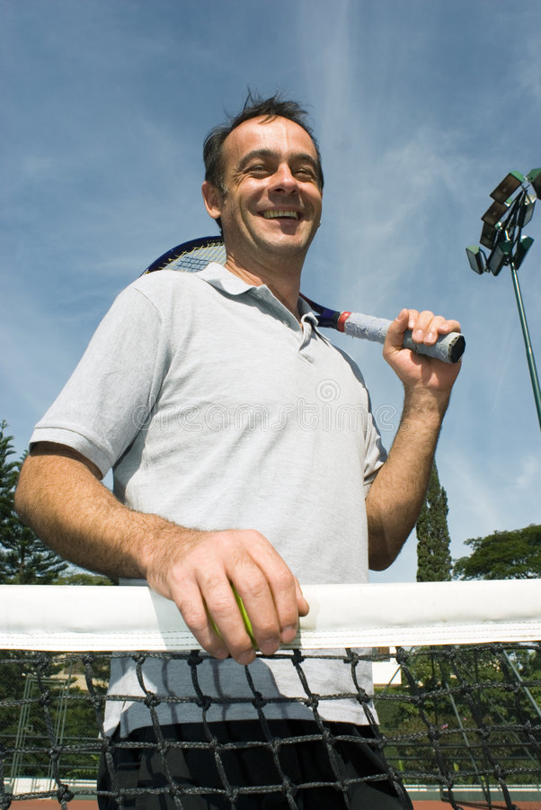 Man on Tennis Court - vertical royalty free stock photography
