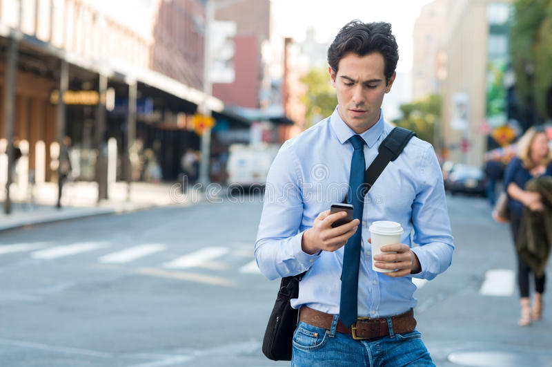 Man texting on phone stock photography