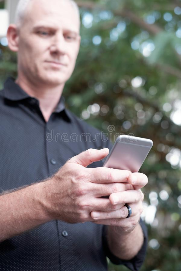 Man Texting On Smartphone stock images
