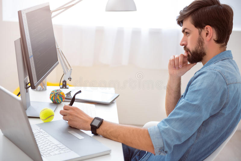 Man thinking in front of computer stock photography