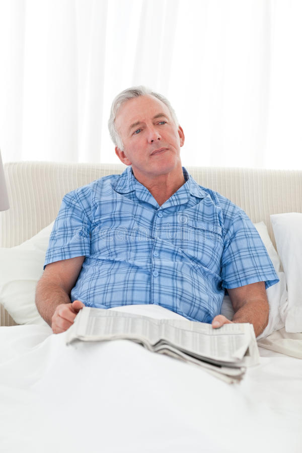 Download Man thinking in his bed stock image. Image of background - 18108181