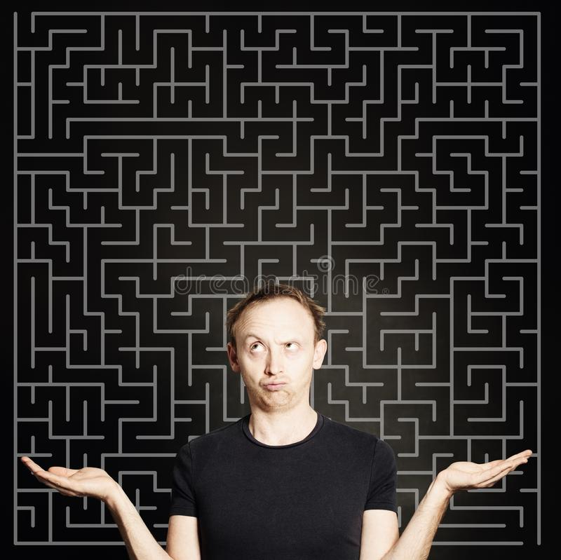 Man thinking and holding two empty open hands. Choice, problem and solution concept stock photo
