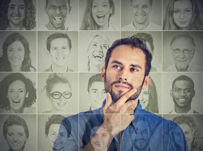 Man thinking looking up at group of multicultural happy people stock photos