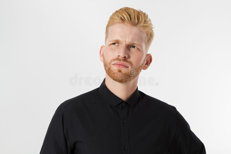 Man thinking, Red hair man serious thinking pensive portrait in studio isolated over white background, Young attractive man in royalty free stock photos