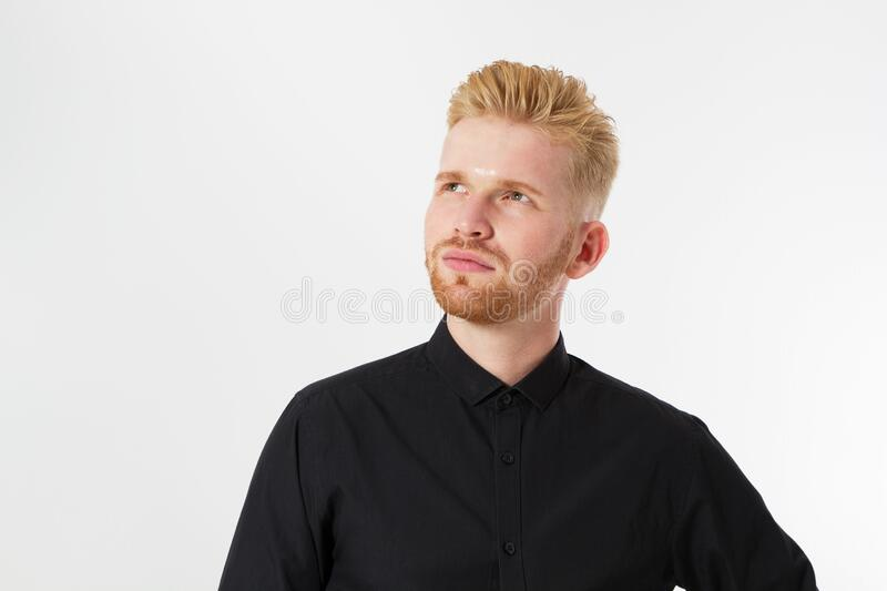 Man thinking, Red hair man serious thinking pensive portrait in studio isolated over white background, Young attractive man royalty free stock images