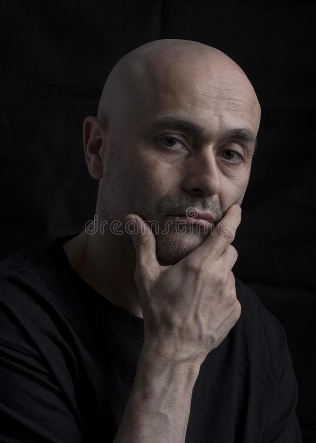 man thinking with serious look royalty free stock photography