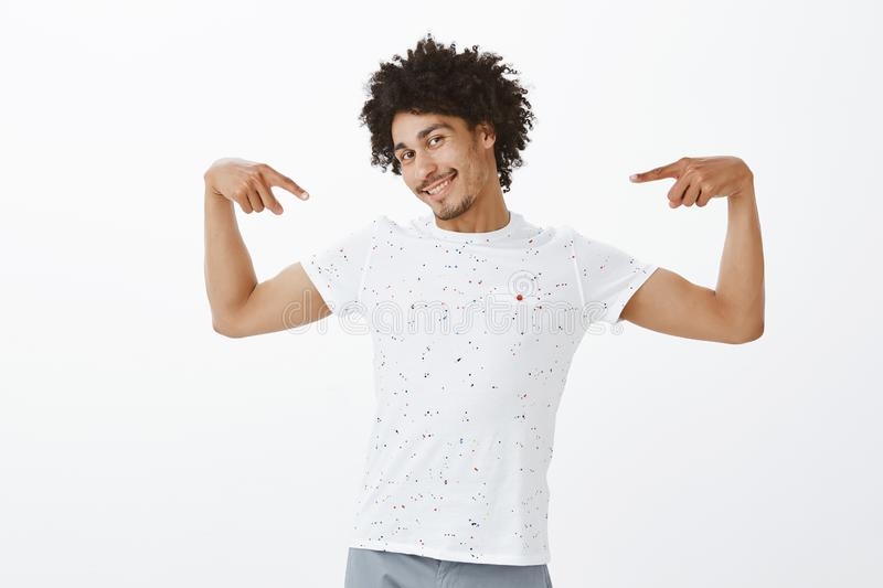 Man thinks girlfriend lucky to have him. Portrait of confident and cute flirty hipsanic boyfriend with afro haircut and royalty free stock photo