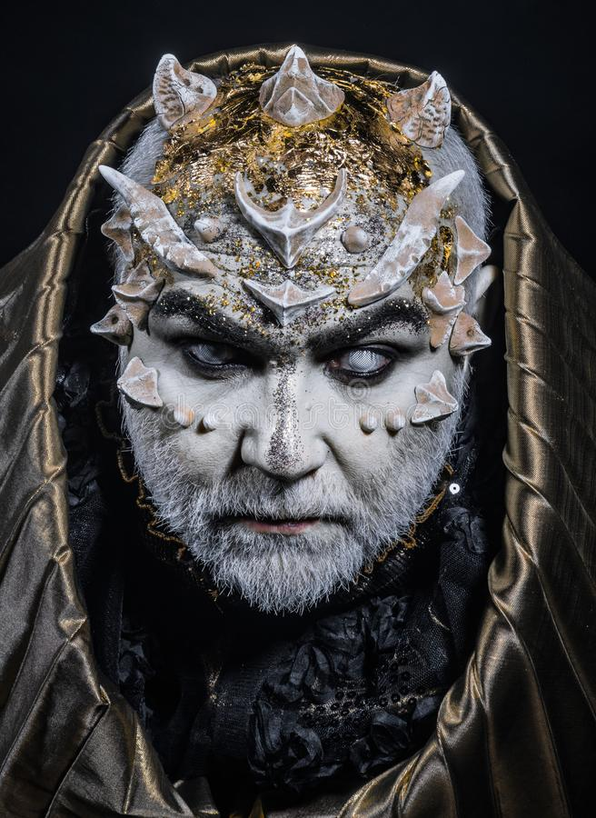 Download Man With Thorns Or Warts, Face Covered With Glitters. Demon With Golden Hood On Black Background. Senior Man With White Stock Image - Image of mystery, concept: 120506641