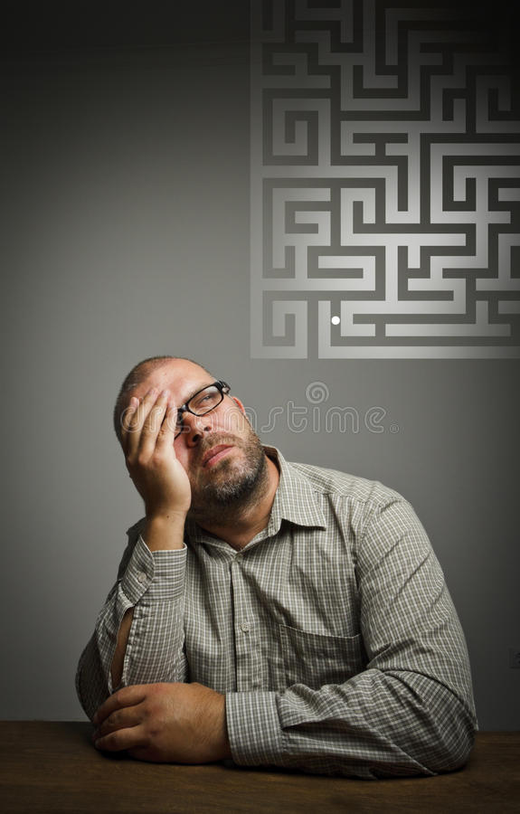 Man in thoughts. Dreamer and maze. stock photos
