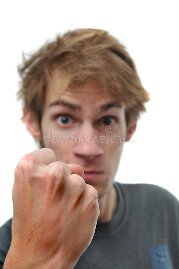 Man threatening with clenched fist royalty free stock image