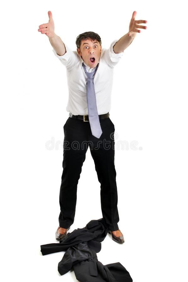 Man throwing his jacket down. Mature businessman throwing his jacket down on the floor in frustration and anger and raising his arms in the air belligerently royalty free stock image
