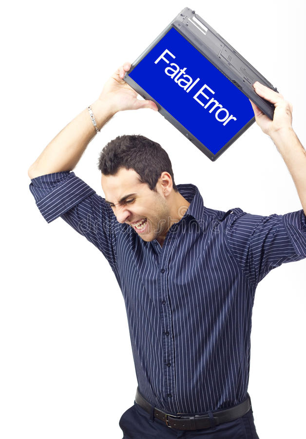 Man throwing laptop because of a system error stock image