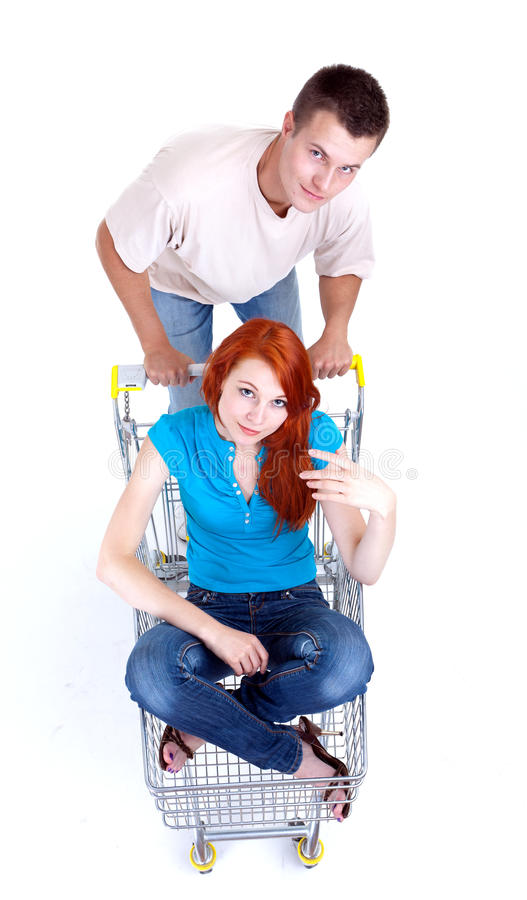 Download Man Thrusting Shop Trolley With Woman Stock Photo - Image: 16201384