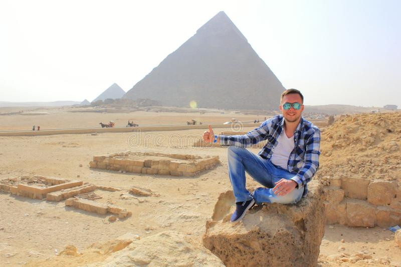 Man thumb up with Egypt pyramids and desert view royalty free stock photo