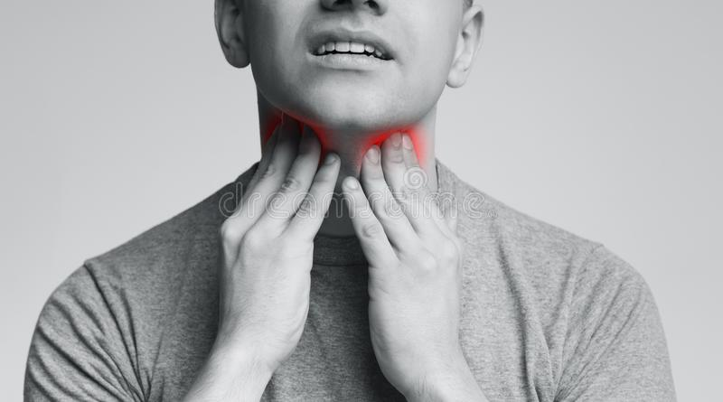 Man with thyroid gland problem, touching his neck. Close up, panorama royalty free stock photo