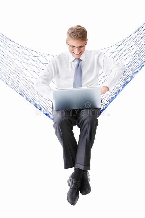 A man in a tie with a laptop. In a hammock isolated stock images