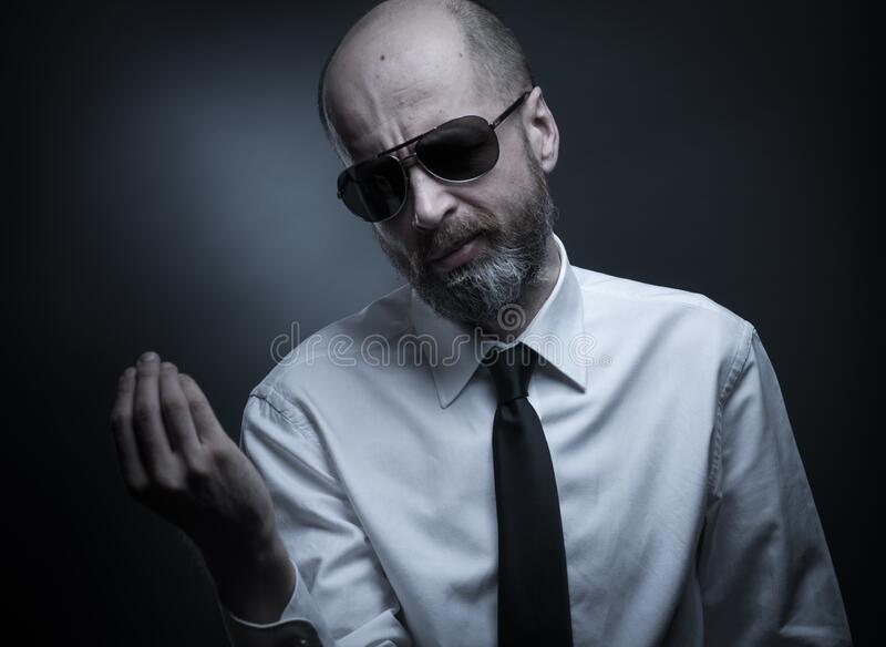Man with tie and sunglasses stock photography