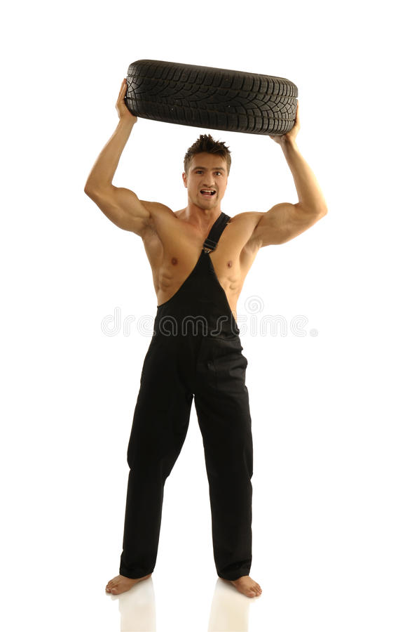 Download Man with tires stock image. Image of maintenance, repair - 16967731