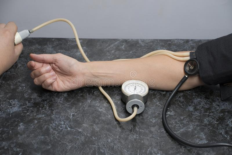 Heart rate and blood pressure measured royalty free stock photo