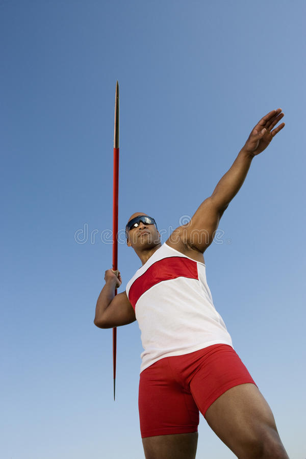 Man About To Throw Javelin Against Sky stock image