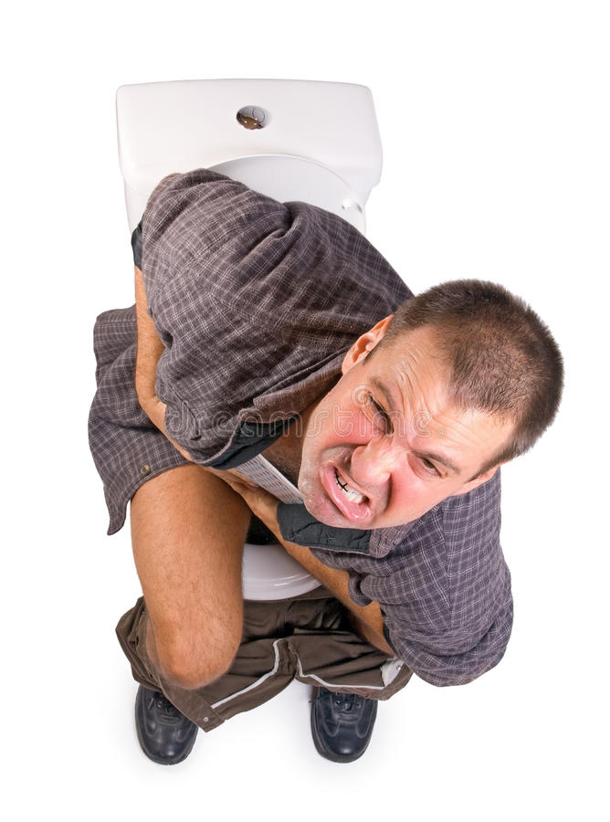 Man on the toilet. Man with Intestinal problems sitting on the toilet stock photo