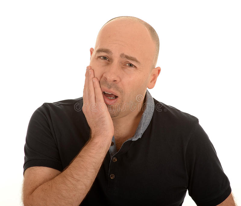 Man with tooth ache. Man in brown shirt looking distressed, holding his face with the right hand clearly suffering with tooth ache, on a white background royalty free stock photo