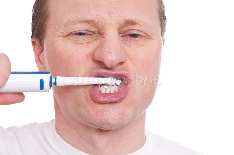 Download Man With Toothbrush Is Cleaning His Teeth Stock Photo - Image of electrical, caucasian: 23116738