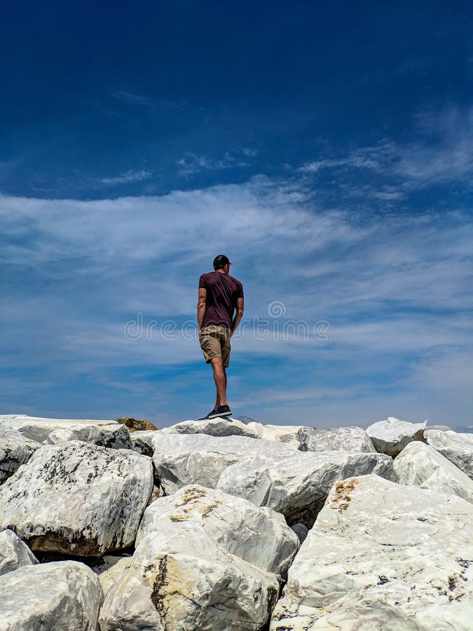 Man on the top of the cliff royalty free stock photo