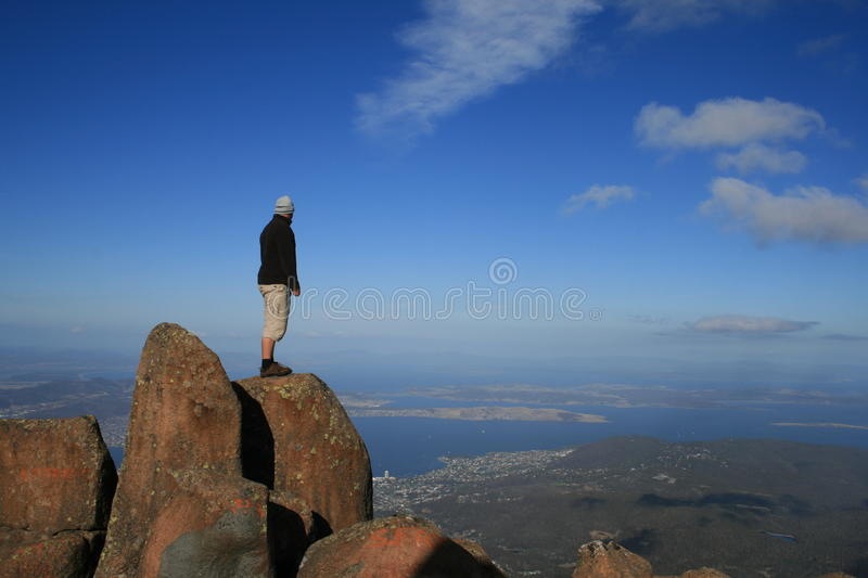 Man on top of a Mountain royalty free stock image