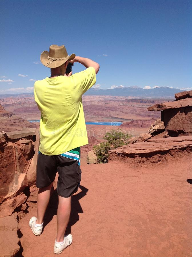 Man at the top of the mountain at Dead Horse Point stock image