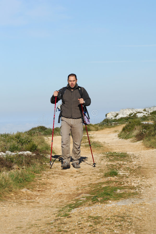 Man in a top of a in mountain hiking stock image