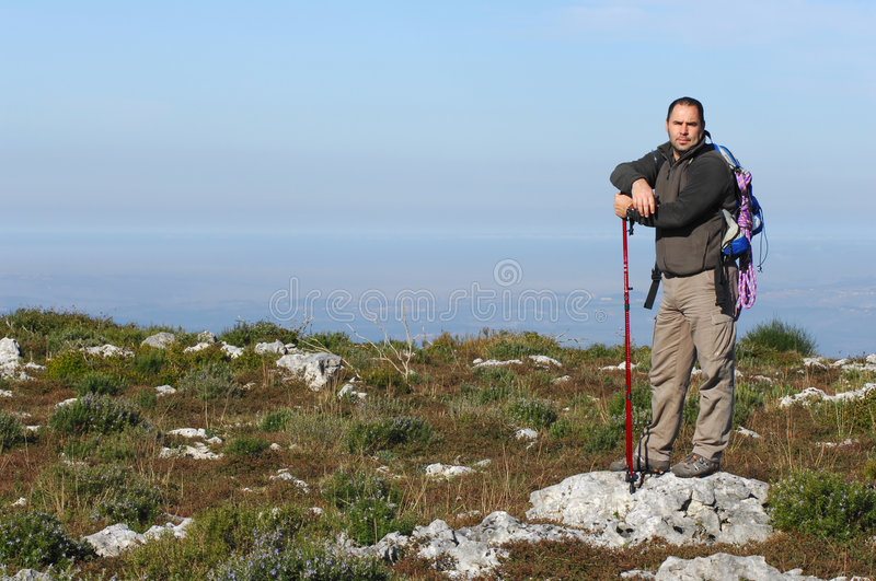 Man in a top of a in mountain hiking stock photos