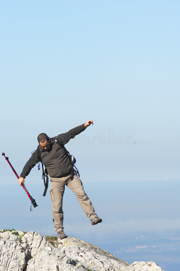 Man in a top of a in mountain hiking royalty free stock photos