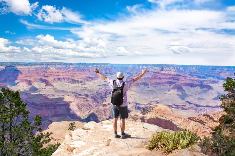 Man on top of the mountain with raised arms. royalty free stock photography