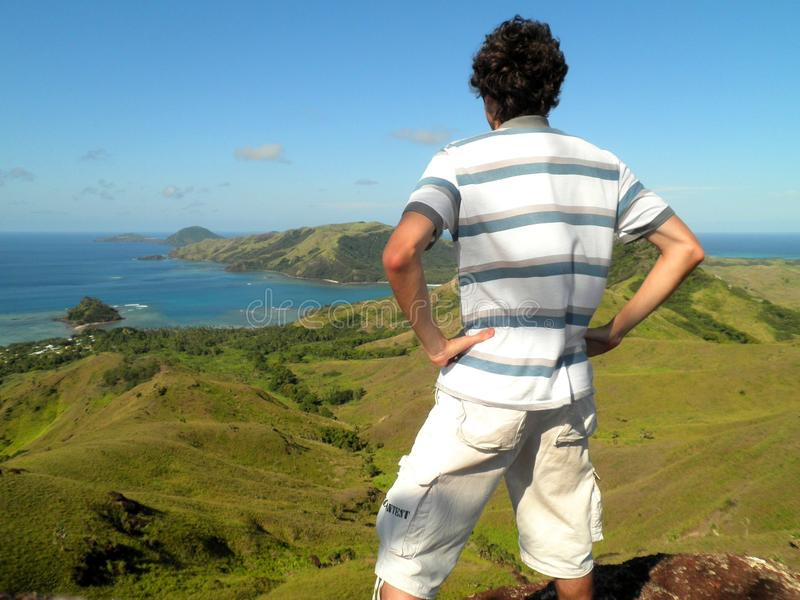 Man Top of Mountain. Young man in top of a mountain in Fiji Islands stock photography