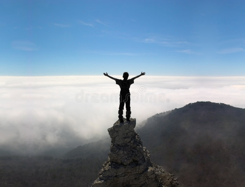 Man on the top of a rock royalty free stock images