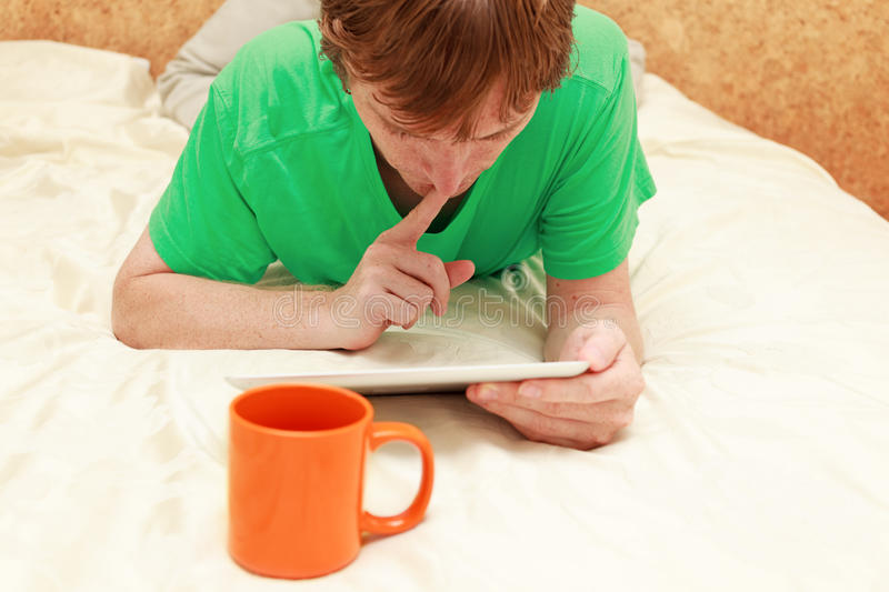 Man with touch pad at home royalty free stock photos