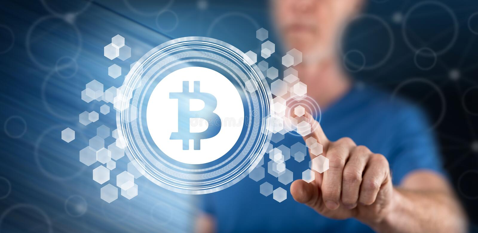 Man touching a bitcoin concept royalty free stock image