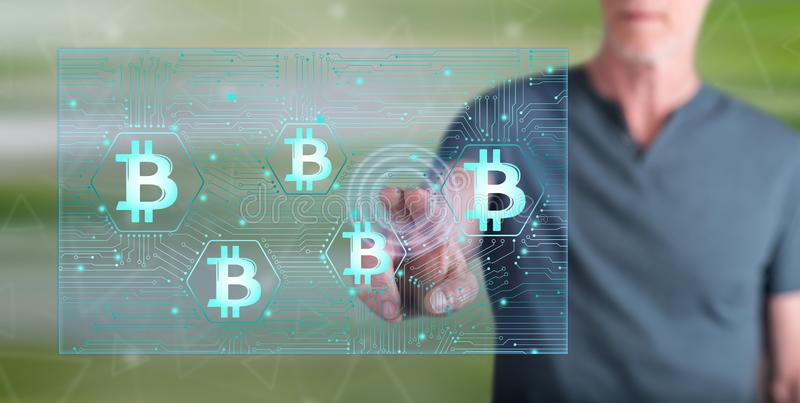 Man touching a bitcoin concept stock photography