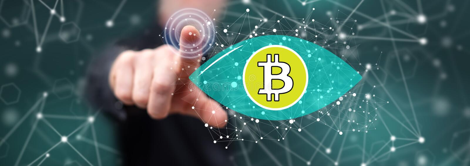 Man touching a bitcoin concept stock image