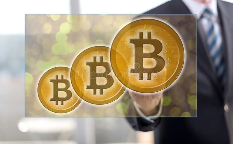 Man touching a bitcoin currency concept royalty free stock photography
