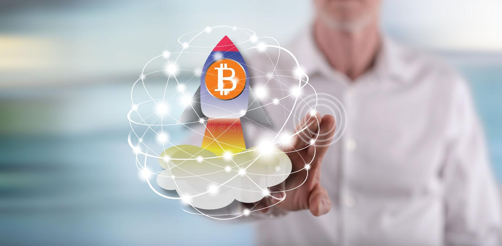 Man touching a bitcoin rise concept on a touch screen. With his finger stock photo
