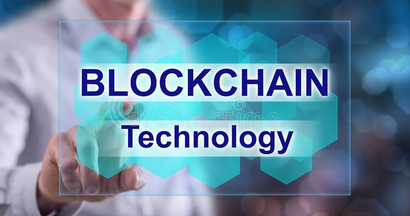 Man touching a blockchain concept stock photography