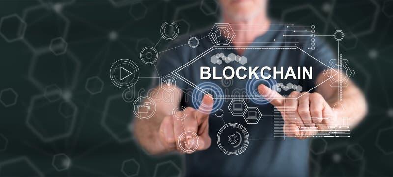 Man touching a blockchain concept stock photo