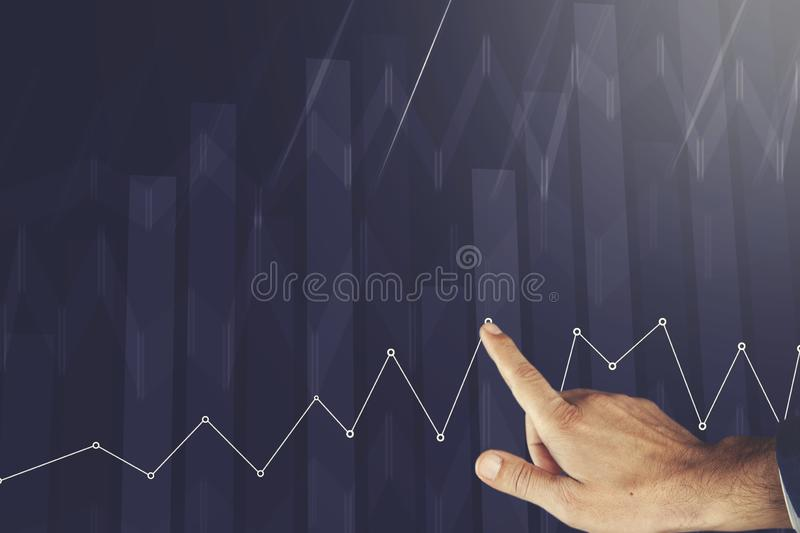 Man touching business charts royalty free stock photography