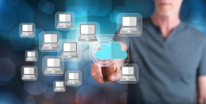 Man touching a cloud computing concept stock image